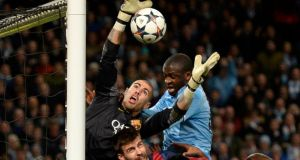 Manchester City's Yaya Toure (centre) tries to score past Barcelona's goalkeeper Victor Valdes (left) during the Champions League round of 16 first leg match at the Etihad Stadium in Manchester. Photograph: Nigel Roddis/Reuters