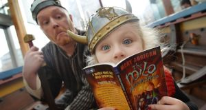 "Kelly Saunders (5) from Tallaght with ""Viking"" Ros Crammond at the launch of World Book Day. Photograph: Alan Betson"