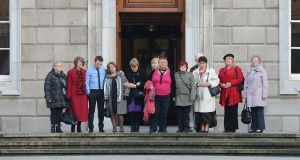 Survivors of Magdalene Laundries on their way into the Dáil last year. One year later, protesters say redress, recommended by the Quirke report and backed by the Department of Justice and Equality, has not been forthcoming for many survivors. File photograph: Alan Betson/The Irish Times