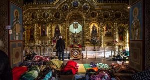 Anti-government protesters sleep on the floor inside the Mikhailovsky Monastery, which has been converted into a makeshift hospital, in Kiev. Photograph:  Brendan Hoffman/Getty Images
