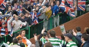"Celtic and Rangers fans taunt each other at an Old Firm derby. But can they really be seen as ""two sides of the same debased coind""? Photograph: PA"