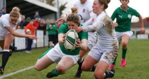 Ireland's Alison Miller goes over against England in last year's Six Nations game in Ashbourne.