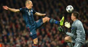 Bayern Munich's Arjen Robben (left) just before he was taken down by   Arsenal's goalkeeper Wojciech Szczesny (right) in London. Photograph: Peter Kneffel/EPA