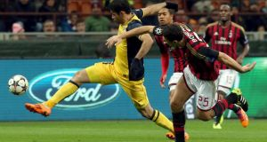 Daniele Bonera (right) of AC Milan fights for the ball with Diego Costa of Atletico Madrid  in Milan. Photograph: Matteo Bazzi/EPA