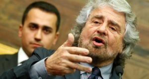 Leader of the Five-Star Movement Beppe Grillo talks to reporters at the end of consultations with Italian prime minister-designate Matteo Renzi at the parliament in Rome yesterday. Photograph: Tony Gentile/Reuters