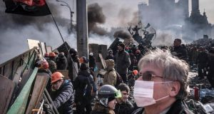 Protesters stand at barricades at the edge of the protest camp in Independence Square in Kiev, Ukraine. Photograph: Sergey Ponomarev/The New York Times