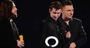 Alex Turner of Arctic Monkeys receives the award for Best British Group at The Brit Awards 2014 at 02 Arena in London last night. Photograph:  Ian Gavan/Getty Images.