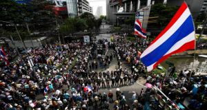 Anti-government protesters gather outside a business building owned by SC Asset Corp during a rally in Bangkok today. Photogaph: Athit Perawongmetha/Reuters.