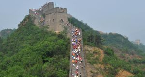 Hitting the Wall yet? Runners compete in the Great Wall marathon at Huangyaguan (Yellow Cliff Pass) Great Wall of China in Tianjin. The race is regarded as one of the most challenging marathons in the world. Photograph: STR/AFP/Getty Images