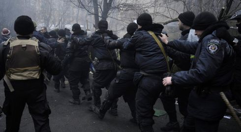 Protesters lead riot police away in Kiev. Photograph: Reuters/Maks Levin