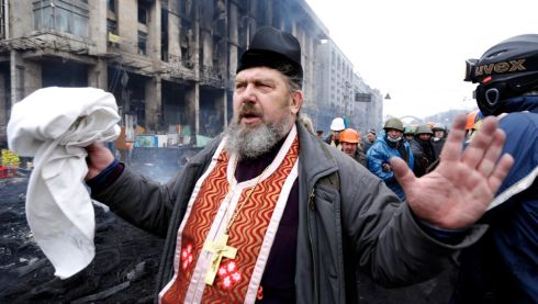 An Otrthodox priest gestures after clashes. Photograph: Reuters/Yannis Behrakis
