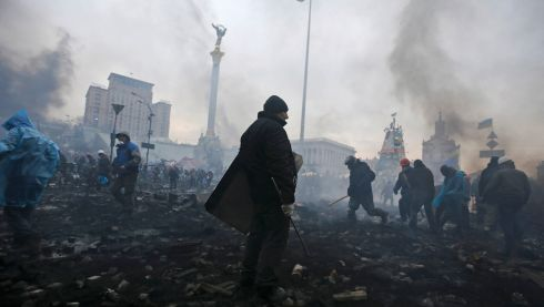 Clashes left rubble strewn in Independence Square after protesters hurled petrol bombs and paving stones at police. Photograph: Reuters/Yannis Behrakis