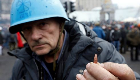 A protester shows a bullet fired in Independence Square. Photograph: Reuters/Vasily Fedosenko
