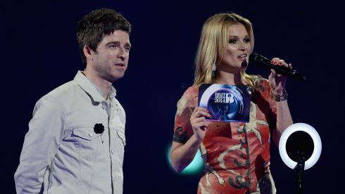 The Brit Awards 2014 were celebrated at the O2 arena in London last night. Model Kate Moss accepted the award on behalf of David Bowie for Best  British Male Solo Artist. Noel Gallagher joined her onstage. Photograph: Ian Gavan/Getty Images
