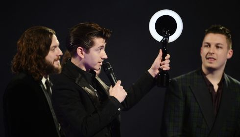Arctic Monkeys took home the British Album of the Year award and were named best group. Front man Alex Turner with band mates Nick O'Malley and Matt Helders enjoy victory. Photograph: Ian Gavan/Getty Images
