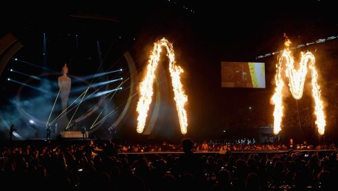 Gigantic first letters of the band's name light on fire on the stage as they perform. Photograph: Ian Gavan/Getty Images