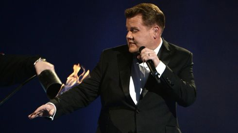 But host James Corden catches on fire after the Arctic Monkeys performance. Photograph: Ian Gavan/Getty Images