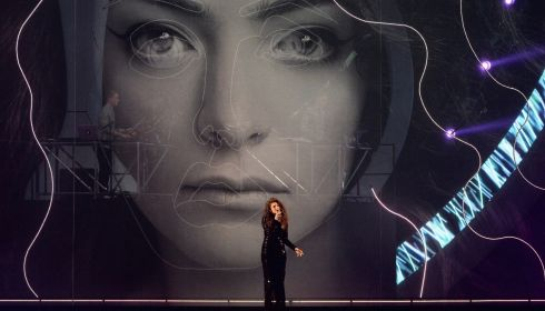 The singer, from New Zealand, performs her song Royals in front of a giant image of her face made from lights. Photograph: Ian Gavan/Getty Images