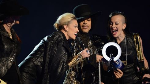 Prince nd his band 3rdEyeGirl present the award for British Female Solo Artist.Photograph: Ian Gavan/Getty Images