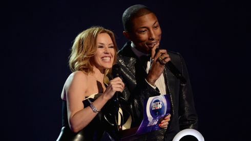 Pop icon Kylie Minogue and singer Pharrell Williams are all smiles as they present the award for International Male Solo Artist. Photograph: Ian Gavan/Getty Images