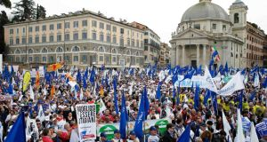 People take part in a rally calling for lower taxes and better protection for small enterprises in downtown Rome
