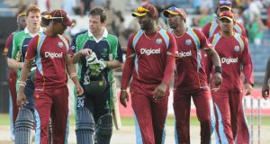 Ed Joyce and Kevin O'Brien leave the pitch with the West Indies players after Wednesday's victory. Photograph: West Indies Cricket Board.