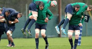 Devin Toner (centre) gives Paul O'Connell a piggyback during Ireland training at Carton House, Maynooth, yesterday. Photograph: James Crombie/Inpho