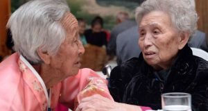 South Korean Lee Young-Shil (right),88, meets with her North Korean sister Lee Jung-Shil during a family reunion after being separated for 60 years. Photograph:  Kim Ju-Sung-Pool/Getty Images