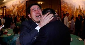 South Korean Park Yang-gon (right), 53, and his North Korean brother Park Yang-su, who was abducted by North Korea, cry during their family reunion at the Mount Kumgang resort in North Korea. Photograph: Korea Pool/News1/Reuters