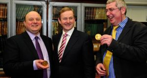 Taoiseach Enda Kenny  at the Royal Irish Academy  where he attended the awarding of gold medals to  Prof Rob Kitchin (left) and Prof  Colin O'Dowd.P hotograph: Aidan Crawley