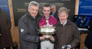 Owner Michael O'Leary, jockey Brian O'Connell and trainer Phillip Fenton celebrate Last Instalment's victory in the Gold Cup. Photograph: Inpho/Morgan Treacy