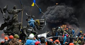 Anti-government protesters continue to clash with police in Independence square, despite a brief truce agreed between the Ukrainian president and opposition leaders.
