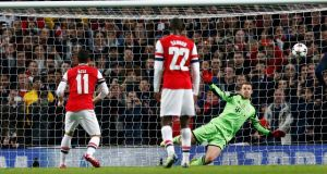 Mesut Ozil's penalty kick is saved by  Bayern Munich goalkeeper Manuel Neuer  during the Champions League match at  the Emirates Stadium. Photograph: Darren Staples/Reuters