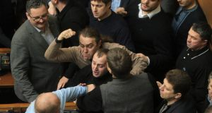 Ukrainan deputies fight during a session of parliament in Kiev today after the speaker declared a pause, delaying a debate on a possible resolution calling for President Viktor Yanukovich's powers to be reduced. Photograph: Alex Kuzmin/Reuters.