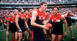 Jim Stynes was honoured by team mates during the 1999 round 1 of the AFL season between Melbourne Demons v Richmond Tigers at the Melbourne Cricket Ground, Australia. Photograph: Hamish Blair/Getty Images