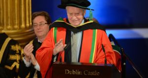 "Philanthropist Charles F. "" Chuck "" Feeney being conferred an Honorary Degree jointly by the Universities of Ireland North and South at a ceremony in Dublin Castle.Photograph: Alan Betson / THE IRISH TIMES"