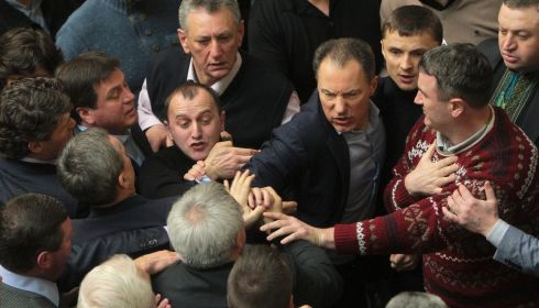 Fighting broke out between deputies in Ukraine's parliament today when the speaker declared a pause, delaying a debate on a possible resolution calling for President Viktor Yanukovich's powers to be reduced.  Photograph: Alex Kuzmin/Reuters