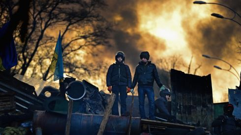 Anti-government protesters men on the front line barricades following yesterdays clashes with police in Independence square. Photograph: Jeff J Mitchell/Getty Images