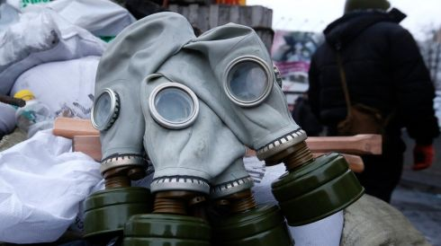 Gas masks hang from the barricade. Photograph: Baz Ratner /Reuters