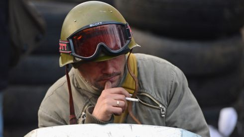 A protester has a cigarette during a lull in fighting. Photograph: Jeff J Mitchell/Getty Images