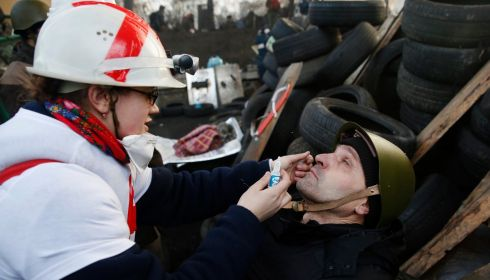 A medic cleans the eyes of an anti-government protester. Photograph: Baz Ratner/Reuters