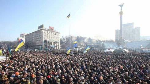 Thousands of people listen to police officers from Lviv who have joined anti-government protesters. Photograph: Olga Yakimovich/Reuters