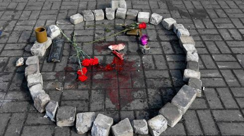 Flowers are placed at the spot where an anti-government protester was killed during yesterday's clashes.Photograph: Vasily Fedosenko/Reuters