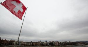 A Swiss National Flag waves over the Rhine in Basel, Switzerland. Photograph: Michele Tantussi/Getty Images
