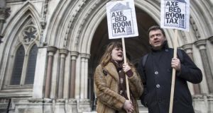 Campaigners demonstrate yesterday outside the Royal Courts of Justice in London against the British government's reform to limit housing benefit, known as the bedroom tax. Photograph: Oli Scarff/Getty Images