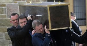 Michael O'Shea's remains are carried in the coffin he made 13 years ago in Ardglass, Co Down. Photograph: Colm Lenaghan/Pacemaker