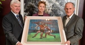 Former president of Ireland Mary McAleese and husband Martin are presented with a painting by GAA president-elect Aogán O Fearghail at the Croke Park Hotel. Photograph: Ramsey Cardy/Sportsfile