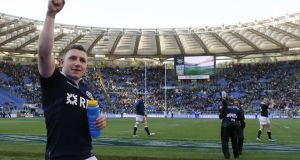 Scotland's Duncan Weir celebrates after his last-minute drop goal secured victory over Italy in their Six Nations clash at the Olympic Stadium in Rome. Photograph:  Giampiero Sposito/Reuters