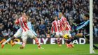 Manchester City's Yaya Toure scores  past Stoke City goalkeeper Asmir Begovic during the  Premier League match at the Etihad Stadium.  Photograph: Martin Rickett/PA
