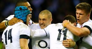 England's Mike Brown (centre) celebrates with teammates after defeating Ireland at  Twickenham. Photograph:  Eddie Keogh/Reuters